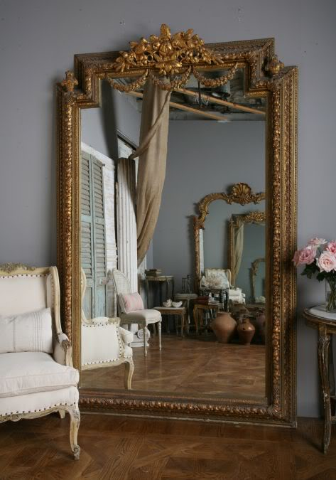 Decorative leaner mirrors places in the home for Big gold mirror