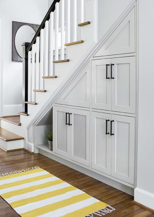 under-the-stairs-pull-out-cabinets-yellow-striped-runner