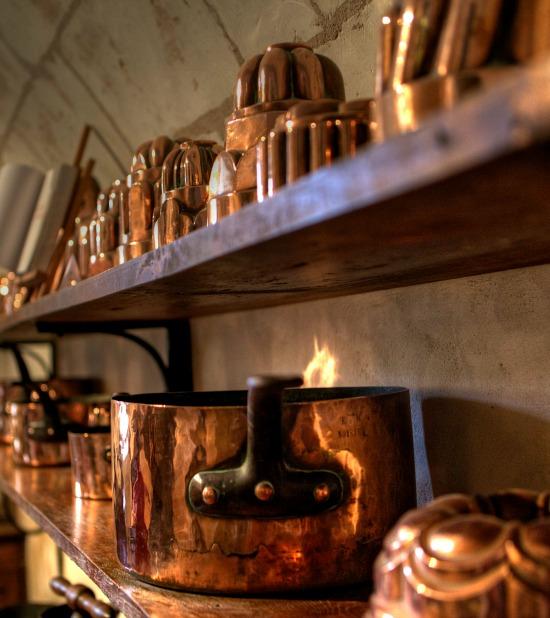copper-pots-molds-on-shelf