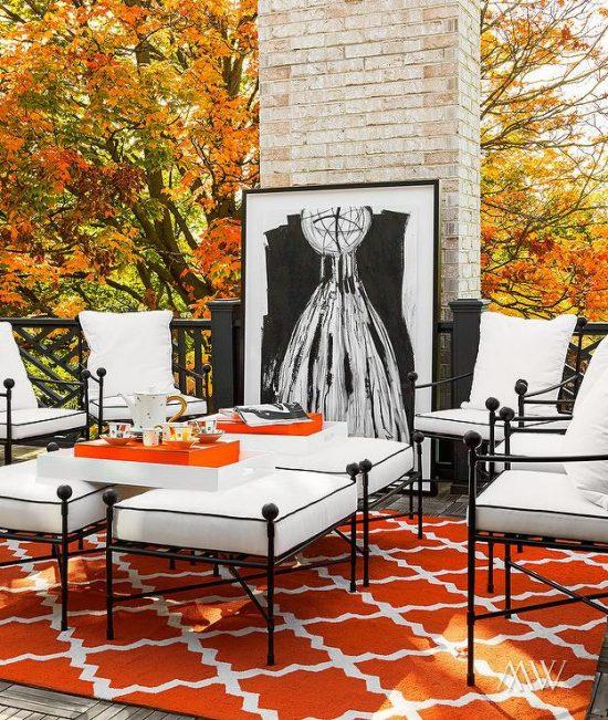 orange-and-black-deck-orange-outdoor-trellis-rug-black-lattice-railing