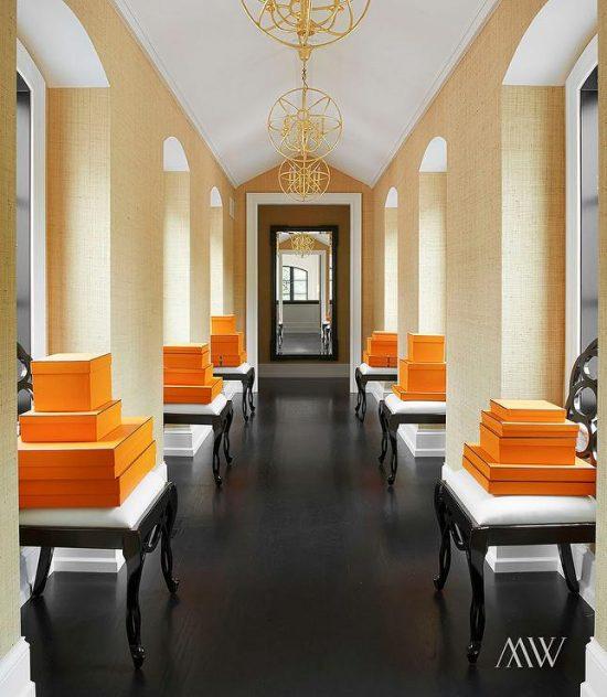 orange-and-black-hallway-hermes-box-black-stools-arched-windows