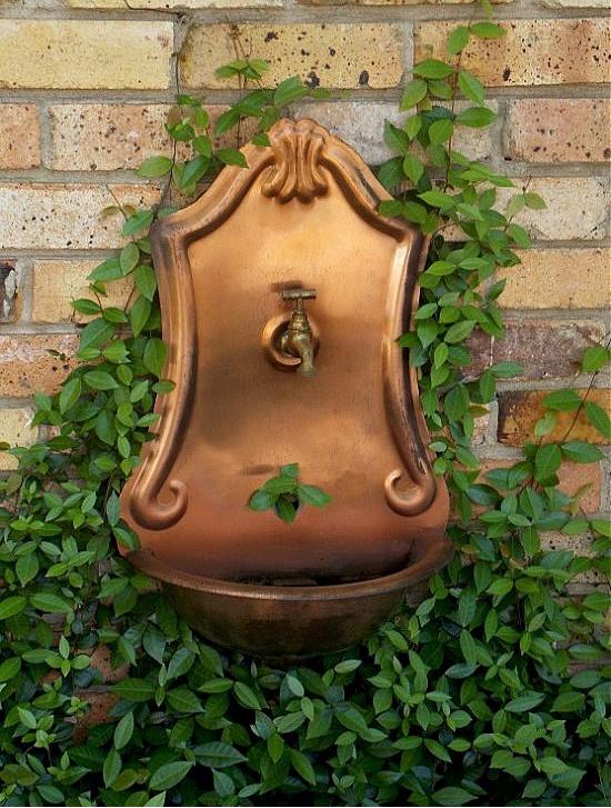 copper-wall-fountain-in-garden
