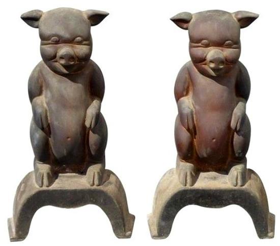 pig shaped iron andirons