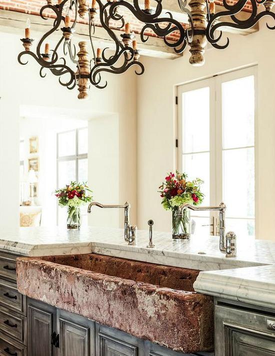 mediterranean-kitchen-distressed-apron-sink-iron-and-wood-chandelier
