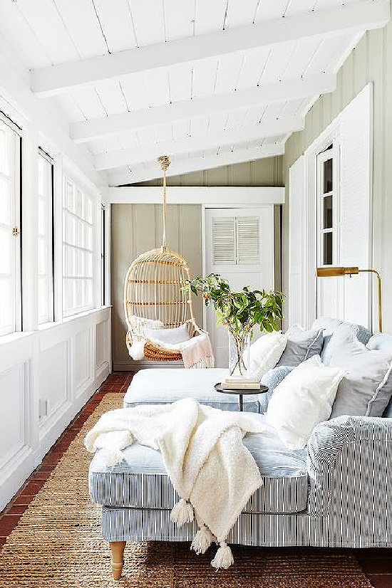 Long Sunroom with Hanging Rattan Chair
