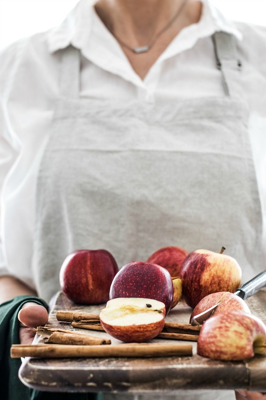 foodiesfeed.com_woman-holding-fresh-apples