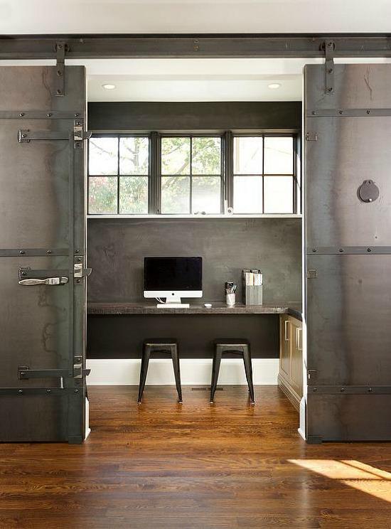 office-black-chalkboard-walls-desk-under-window-double-metal-doors